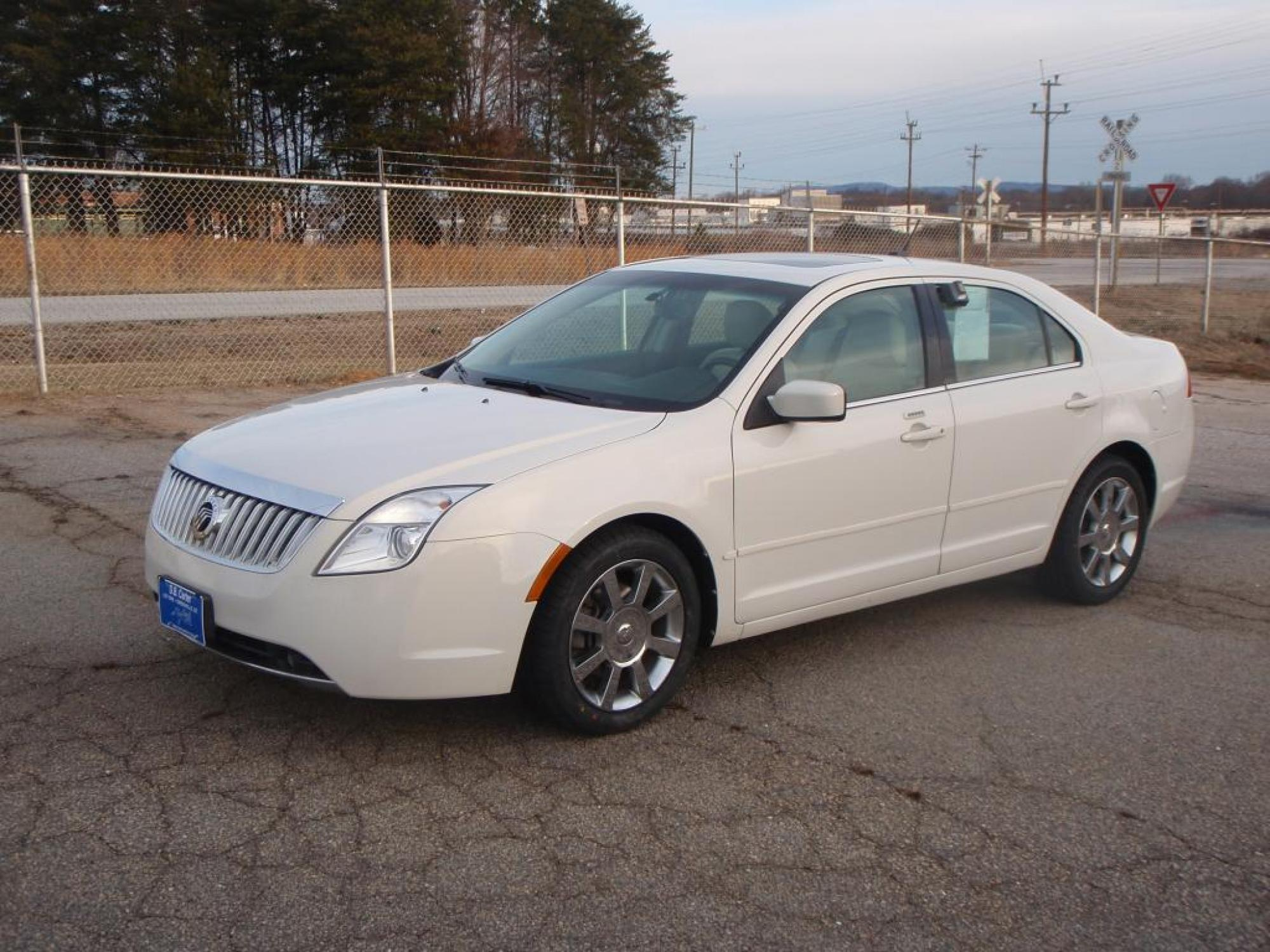 2010 Mercury Milan Voga Sdn FWD Sedan White Tan 25L DOHC Duratec 16-valve I4 engine307 axle ra