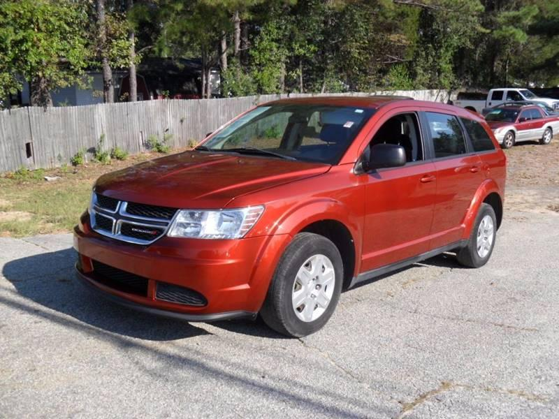 2012 DODGE JOURNEY SE 4DR SUV Orange 113375 miles Stock 373 VIN 3C4PDCAB7CT324400