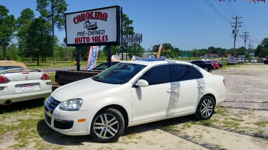 2006 Volkswagen Jetta Base White Air filter Air ConditioningCFC-Free Air ConditioningCenter Arm