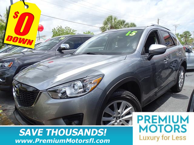 2015 MAZDA CX-5 FWD 4DR AUTOMATIC TOURING LOADED SAVE THOUSANDS At Premium Motors we have