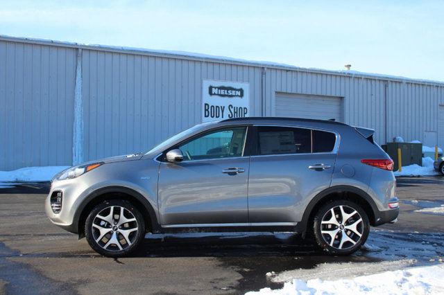 2018 KIA SPORTAGE SX TURBO AWD KEY FEATURES AND OPTIONS Comes equipped with Air Conditioning Sun