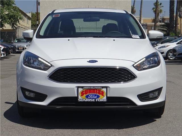 2015 Ford Focus SE Sedan Miles 1Color OXFORD WHITE Stock M52559 VIN 1FADP3F2XFL334492