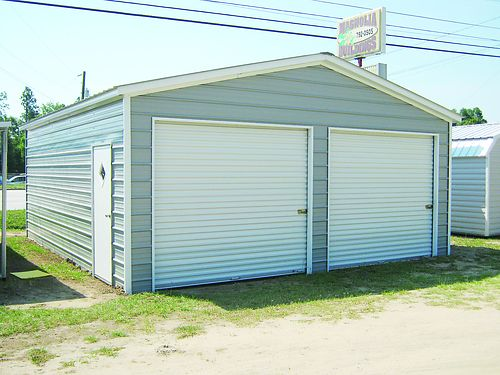 22x24x9 Vertical Roof Enclosed Garage 1-36x80 Walk-in Door 1 Window 2-9x8 Roll-Up 5855 12x20