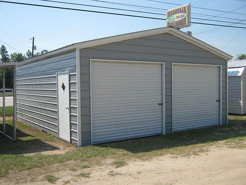 VERTICAL BOX EAVE 22x26x9 Enclosed Garage 1-36x80 Walk-in Door 1 Window 2-9x8 Roll-Up 5370 1-8