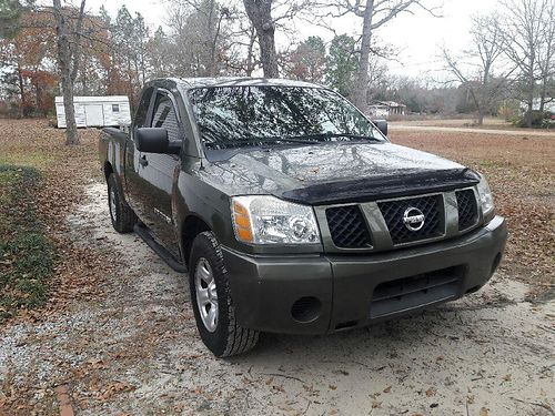 2005 NISSAN TITAN KING CAB v-8 56 green in color with tinted windows 109k miles xc running boa