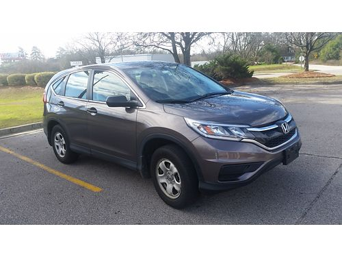 2015 HONDA CRV LX 29500 miles one owner gray in color gray int 4dr bluetoothxc with warranty