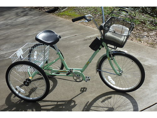 TRICYCLE like new includes parking brake front pet basket and rear large basket 350 obo prefe
