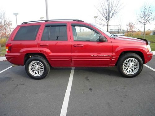 2003 JEEP GRAND CHEROKEE LIMITED  1 owner lady driven Straight 6 cyl fully loaded leather sunr