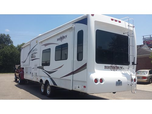 2010 HEARTLAND BIGHORN 34 5th wheel one owner 3 slides including king bed new g rated goodyear t