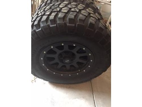 TIRES 5 30565r17 Bf Goodrich MTs and M offroad rims with over 12 tread 1 new never been on