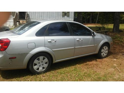 2006 SUZUKI FIRENZA loaded 130k miles xc salvage title 2950obo or trade for zero turn mower for