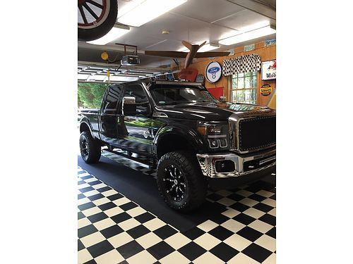 2013 FORD F250 diesel black fx4 4x4 lifted top of the line many upgrades garage kept 84k mile