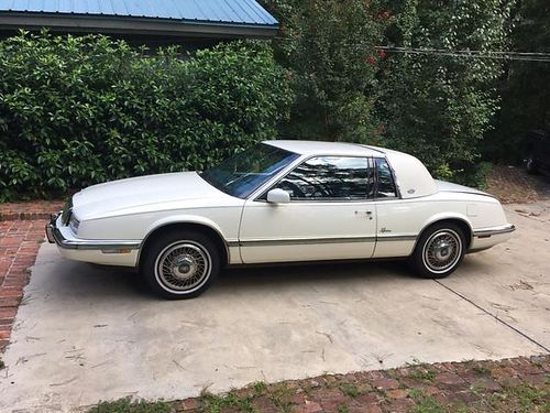1990 BUICK RIVIERA CLASSIN white in color 129k miles with a little cosmetic work this car could be