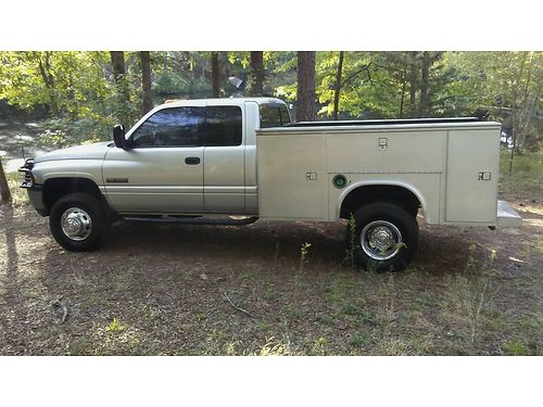 2001 DODGE RAM 3500 SLT quad cab 4x4 dually silver in color 1 owner 59 liter cummings diesel 6s