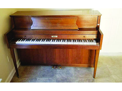 UPRIGHT Becker PIANO used in time for Christmas great for learning or for home use 400 or best of