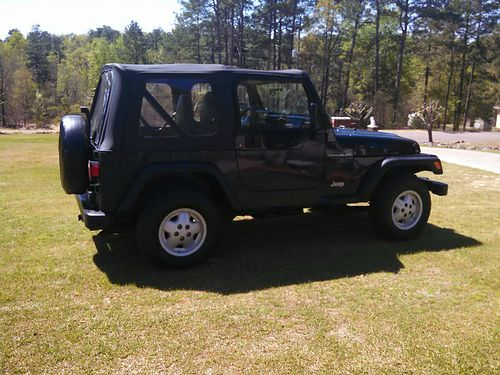1998 JEEP WRANGLER 2dr soft top v-4 5sp manual trans 138k miles 6900 for color photos search Iwa