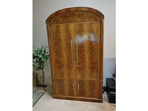 ENTERTAINMENT CENTER can be converted into an armoire 50x25 retail 8000 asking 800 serious inquir