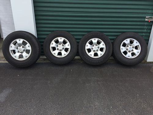 WHEELS TIRES factory P24575R26 Dunlop AT20 Grand Trek fits 2006 Toyota Tacoma 6 lugg approx 50