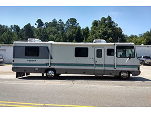 1993 GEORGIE BOY 32 good condition 32K miles sleeps 6 dual ac self contained generator lp tan