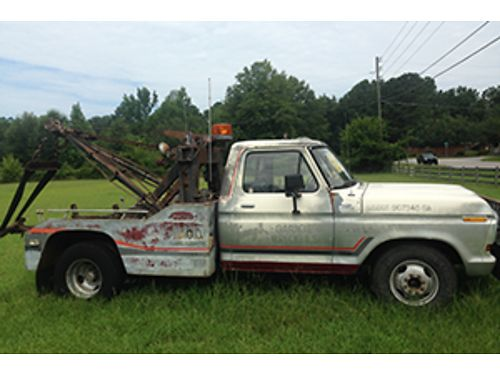1979 FORD F350 with Holmes 480 wrecker bed 5 speed with granny gear everything works 2500 firm