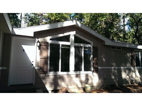 OWNER MAY CARRY with 75k down 3-bed 2-bath 1512sf 2011 MFG home on 33 acres Lakehead like new