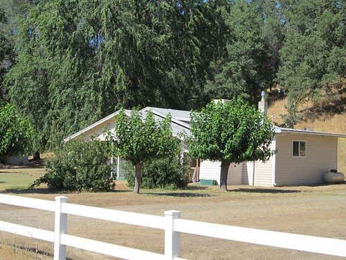 FIVE MINUTES from the mall 62-acres plus 2-bedroom 2-bath home also extra fixer mobile home pl