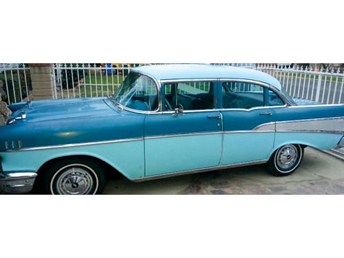 1957 CHEVROLET BELAIR 283 eng 8 cyl 4 doors auto new tires front swag bars dual twin pipes fende