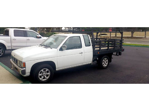 1997 NISSAN FLATBED - 5spd man runs very good 5500 obo or trade for big truck plus cash 805-509-6