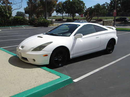 2000 TOYOTA CELICA 5 spd 4 cyl runs great great on gas slvg ttle super fast in good shape go