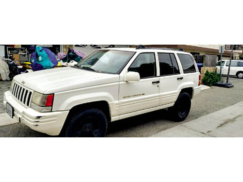 1997 JEEP GRAND CHEROKEE runs really well new straight 6 engine wlow mi and new tires leather f