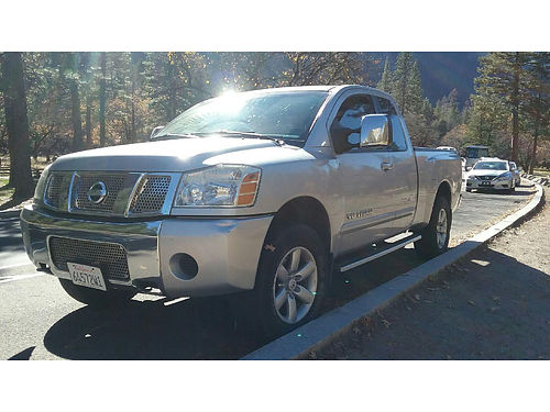 2005 NISSAN TITAN EXT CAB 4x4 auto V8 all pwr bedliner AC CD good tires step bars 132K mi