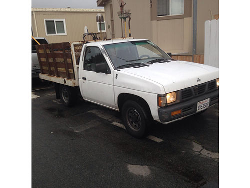 1996 NISSAN FLATBED Stakesides 5 spd 4cyl runs good ready for work se habla espenglish 2800