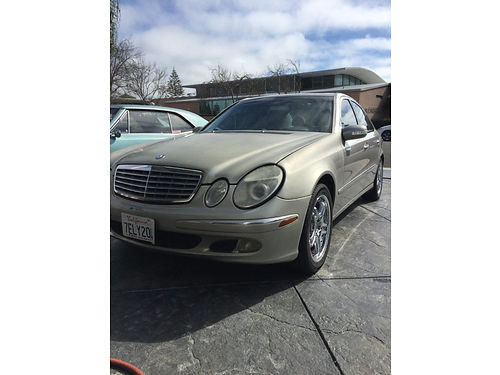 2003 MBZ E550 4 door runs good snrf custom wheels smog check registered pw pdl salvage titl
