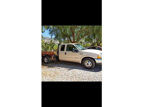 1999 FORD F350 EXT CAB FLATBED Dually 73L diesel reblt eng wonly 500 mi  ext parts wreceipts