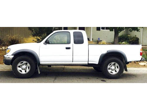 2004 TOYOTA TACOMA PRERUNNER extracab 4 cyl 27L auto am-fm Cd tan int great cond 158k miles