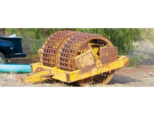 COMPACTOR Road maintainer for construction 12000 pound selling for 5000