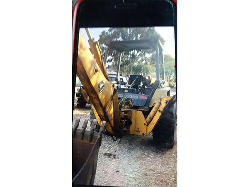 1991 JD 210C 4X4 BACKHOE 4 cyl diesel runs and works great NO REVERSE 8000