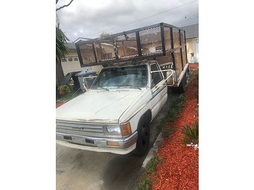 1988 TOYOTA PICKUP Open cage box bed auto 4cyl dual axle runs good 3 months DMV plates expired