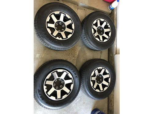 STOCK WHEELS New alloys 6 lug only 300 mi on it fits any Toy 4 runner or Tundra yr 2000 or older