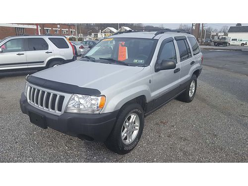 2004 JEEP GRAND CHEROKEE LAREDO 4WD auto6 cyl AC tilt cruise AMFMCD full power options ser