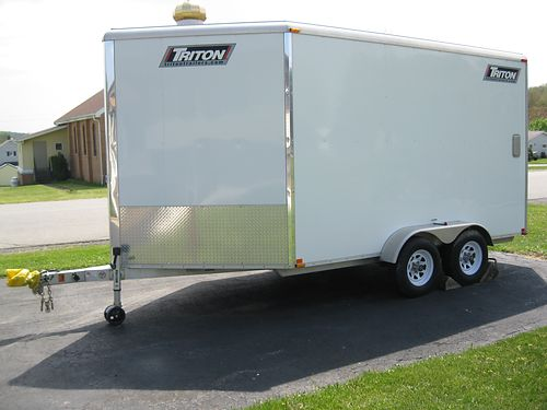 2012 TRITON trailer enclosed model 127-2 v nose 76Hx12L man door spare tire  wheel spare