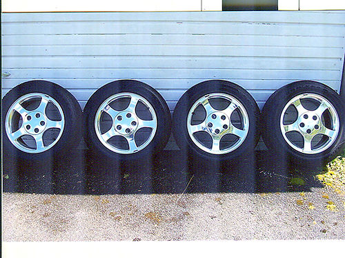 TIRES  WHEELS 4 new only 25 miles GoodYear All-Season 22555-16 tires cost over 600 for tires