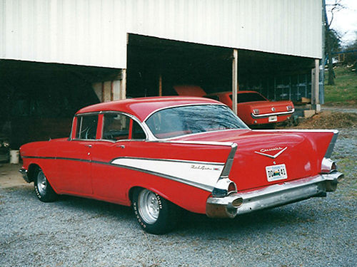 1957 CHEVY red 4dr post 283 engine 3spd completely redone interior runs  looks good 10000 4