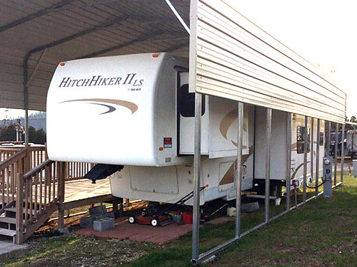 2005 NUWA HITCHHIKER II LS fifth wheel 345ft 4slide-outs 40ft carport cover 8x24ft deck slee