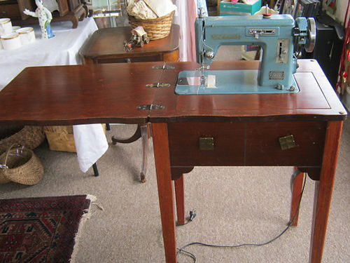 SEWING MACHINE VTG Stitchmaster in cabinet needs work can be seen at Artiques on Commerce St in
