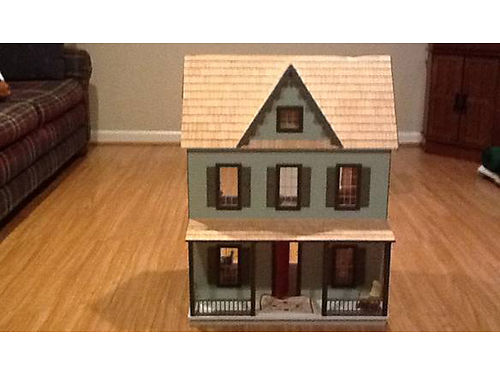 DOLL HOUSE Wooden doll house fully furnished with dolls Good condition 95 423-341-2816