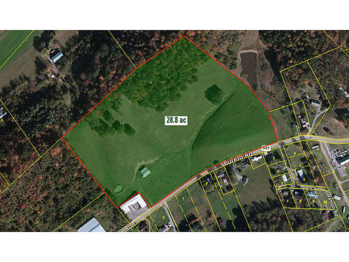 28 ACRE PROPERTY Close to downtown and business district Property formerly used for farm equipment