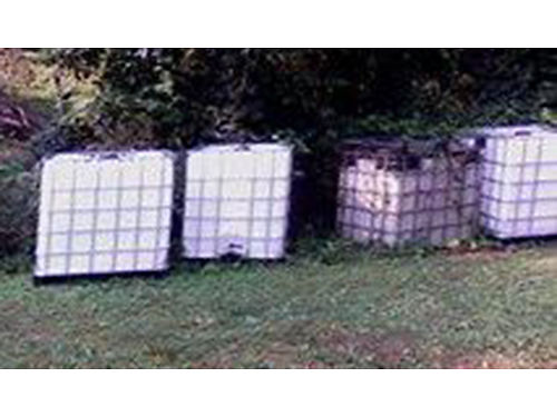 STORAGE CONTAINERS 250 gallon liquid in metal cage great for catching rain water for gardens used