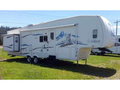 2008 FOREST RIVER Wild Cat 32QBBS 5th wheel 32 2 slides fully self contained sleeps 9 rear