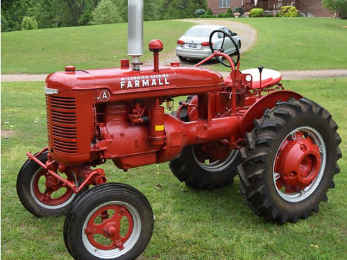 TRACTOR A Farm All incl plows  buzz saw blade good tires  paint 2500 423-345-3199